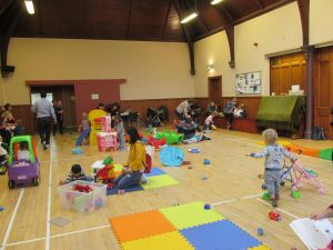 Children playing a church hall